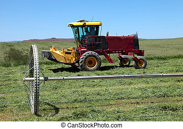 Modern tractor in a field.