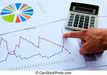 The man's hand specifies the chart of growth, fot business...