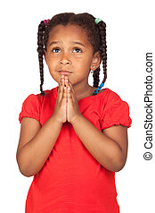 Sad little girl praying for something isolated on a over...