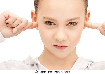 teenage girl with fingers in ears