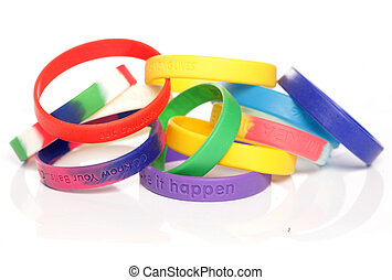 Various charity fundraising wristbands studio cutout