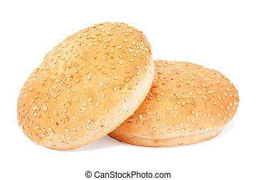 Two white buns with sesame