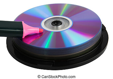 Pink marker on pile of compact disks isolated over white...
