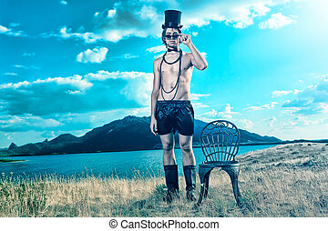 exotic - Fashion shot of a handsome young man posing topless...