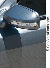 Car blinker - modern car blinker on a gray metallic sports...