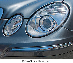 Car head lights - circular car head lights on a gray...