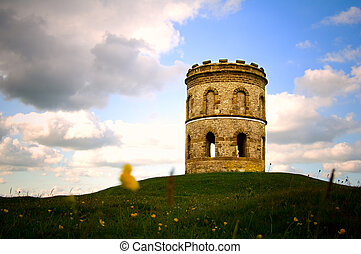 ancient atmospheric tower - an old brick tower with...