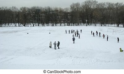 Men play rugby outdoors in winter, time lapse - Young men...