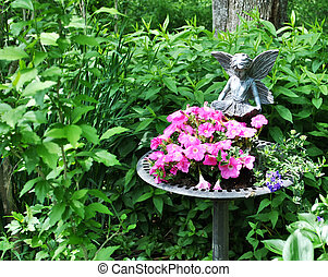 Garden Display - A garden with a display of flowers in a...