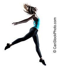 Modern style dancer jumping - Side view of a sporty young...
