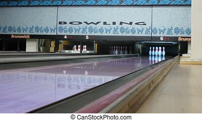 Brunswick pinsetters reset bowling pins in The First club -...