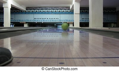 Ball roll through bowling lane and hit pins, time lapse