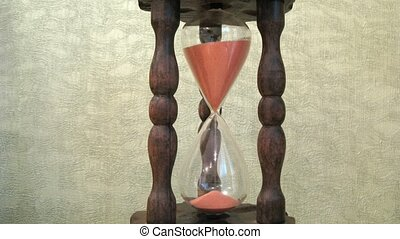 Close-up view on wooden sandglass running, time lapse