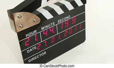 Side view on electronic clapboard, time lapse