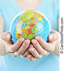 Hands holding globe - Globe of the planet Earth held in...