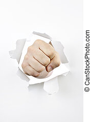 Fist punching through hole in paper