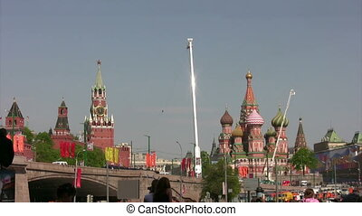 Over Red Square fly group of planes, people observe from...