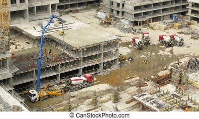 Workers pour concrete at Losiniy Ostrov estate - MOSCOW -...