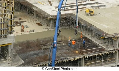 Workers pour concrete using concrete pump at Losiniy Ostrov...