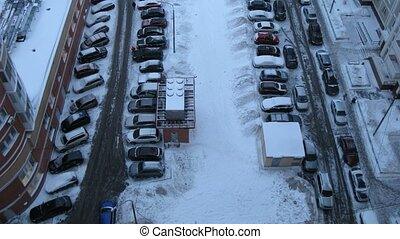 Top-down view on yard full of cars, time lapse