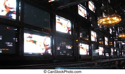 Big video panel consisting from many TV sets, time lapse