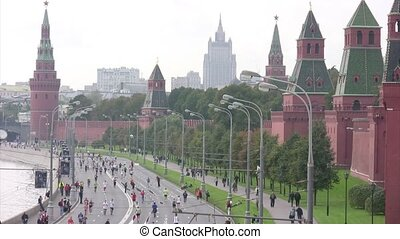Participants run along quay near Kremlin.