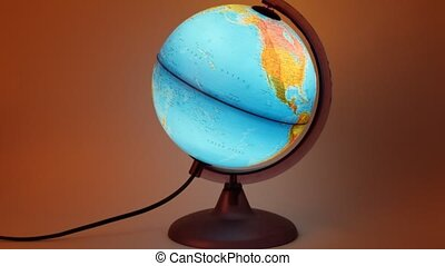 Globe with inner backlight turning around