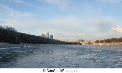 View from boat on icy Moskva-river, time lapse