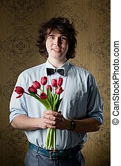Love - An image of handsome man with red tulips