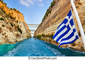 Corinth channel in Greece and greek flag on ship - travel...