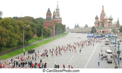 Participants of peace marathon run through Vasilevsky Spusk...