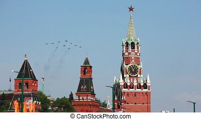 Ten fighter planes aligned delta fly over Red Square -...
