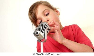 Girl sing in microphone - beautiful girl sing in iron...