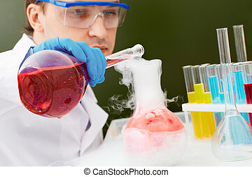 Chemical experiment - Young clinician making experiment with...