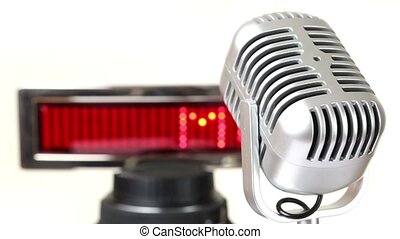 Microphone rotates in front of panel with run string MUSIC