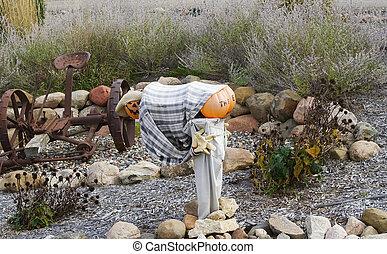 Hay Ride Sculpture for a pumpkin man mooning the croud.
