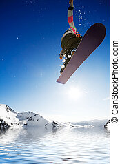 Air born snowboarder - Crossover snowboard, surfing photo...