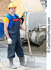 worker with shovel - manual worker with shovel at...