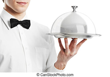 hand of waiter with cloche lid cover