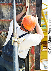 builder at construction work - builder worker at...