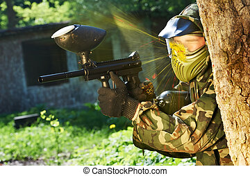 paintball player direct hit - paintball sport player wearing...