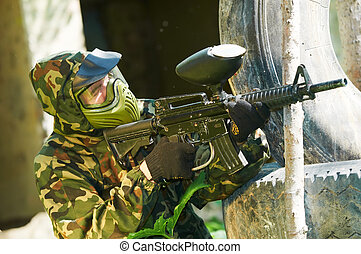 paintball player outdoors - paintball sport player in...