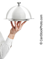 hand of waiter with cloche lid cover - Close up hand of...