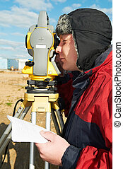 surveyor works with theodolite tacheometer