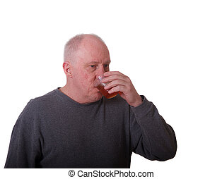 Older Balding Man Drinking from Plastic Cup - An older...