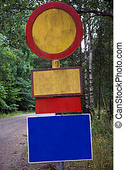 Sign post with many signs in diffe5rent colors