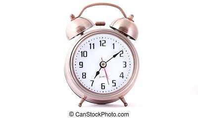 front view of classical metal alarm clock on white