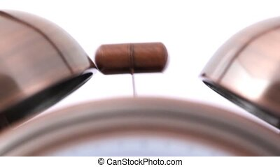 extremely close-up shot of ringing alarm bell clock