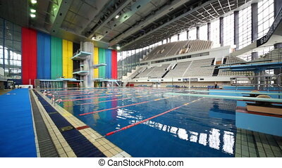 Diving boards and swimming pool at sports complex Olympiysky