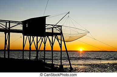 pier with fishing net during sunrise, Gironde Department,...